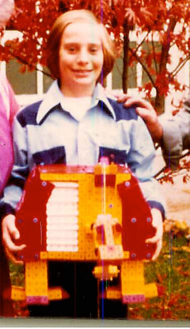 Picture of Paul Fernhout and a robot he built from Togls toy blocks in 1976